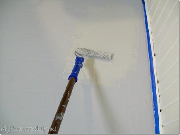 roll paint on vinyl floor
