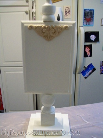 white pedestal display stand