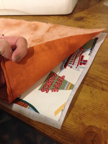 Layer your fabrics and stabilizer so they're sewn right sides together.