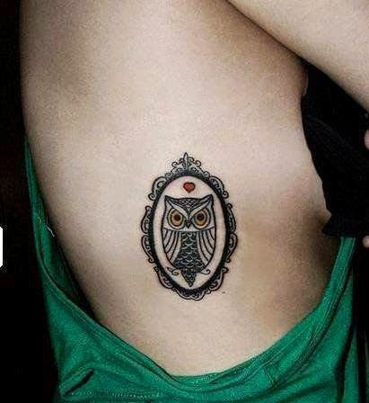 Owl tattoos on side rib