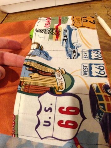 Divide the pocket into several smaller pockets, each sized to fit your toy cars.