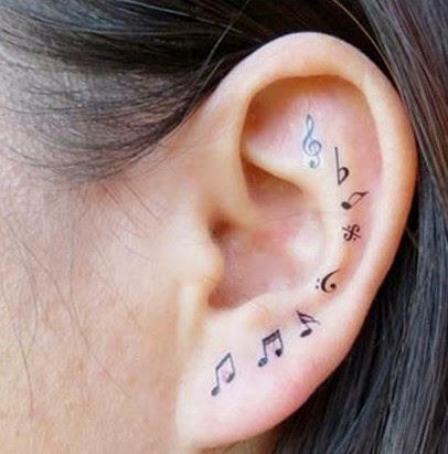 Music tattoos on ear