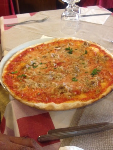 Pizza from a restaurant in Rome