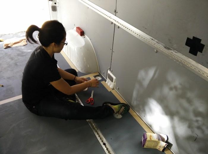 Laying down double sided tape for the Sprinter flooring