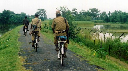 Soldiers of the Indian Border Security Force (IBSF) strict vigil on bi-cycle in India-Bangladesh International Border at Kedar village of Dhubri district of Northeastern Indian State, Assam on 10th April, 2006.(Photo/Shib Shankar Chatterjee)