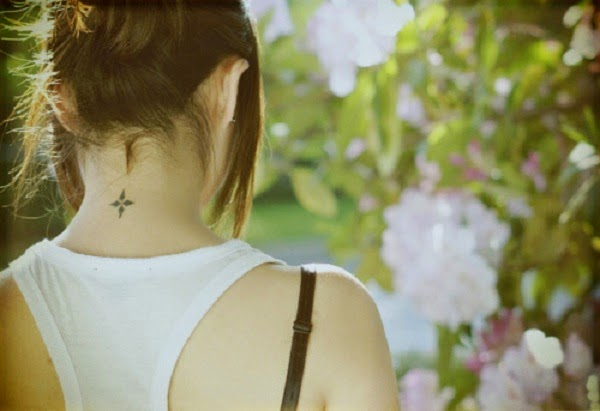 small hidden strength tattoo design on neck