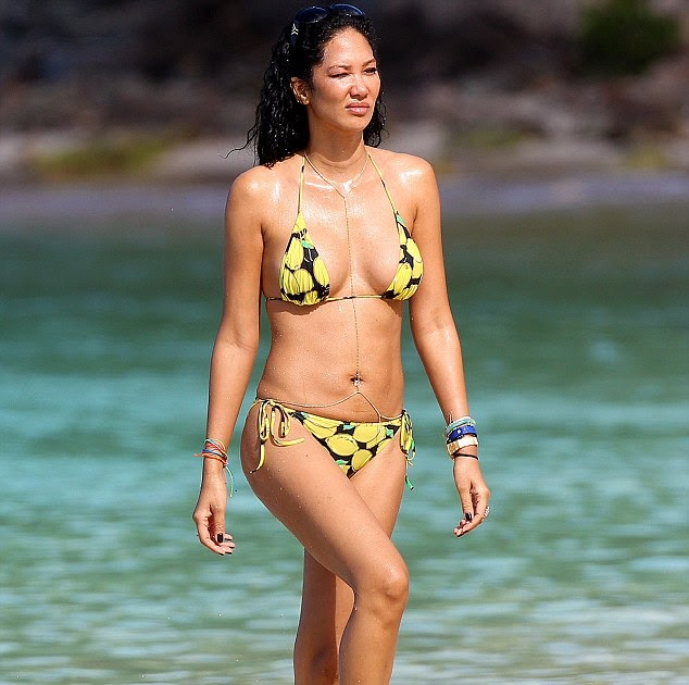 SwimSuitBox Feeling fruity Kimora Lee Simmons shows off
