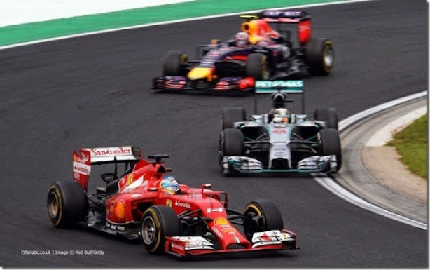 BUDAPEST, HUNGARY - JULY 27:  Fernando Alonso of Spain and Ferrari, Nico Rosberg of Germany and Mercedes GP and Daniel Ricciardo of Australia and Infiniti Red Bull Racing drive during the Hungarian Formula One Grand Prix at Hungaroring on July 27, 2014 in Budapest, Hungary.  (Photo by Lars Baron/Getty Images) *** Local Caption *** Fernando Alonso;Lewis Hamilton;Daniel Ricciardo