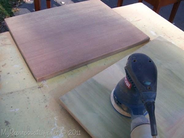 orbital sander on sewing cabinet top