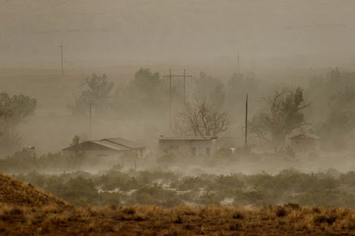 A dust storm blows through the lonely town of Woodside, Utah.