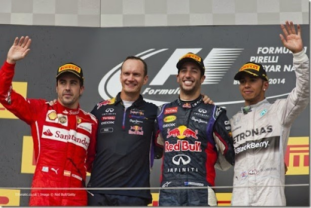BUDAPEST, HUNGARY - JULY 27:  Daniel Ricciardo of Australia and Infiniti Red Bull Racing celebrates victory on the podium next Fernando Alonso of Spain and Ferrari and Lewis Hamilton of Great Britain and Mercedes GP after the Hungarian Formula One Grand Prix at Hungaroring on July 27, 2014 in Budapest, Hungary.  (Photo by Drew Gibson/Getty Images) *** Local Caption *** Daniel Ricciardo;Fernando Alonso;Lewis Hamilton