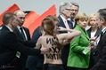 FEMEN-Topless-Protest-Putin-Merkel-VW-2