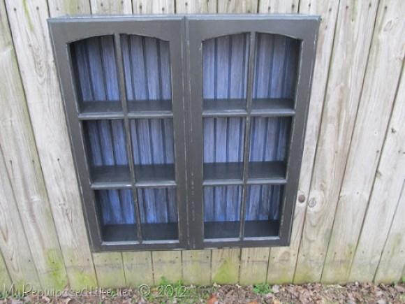 hanging cupboard built from cabinet doors