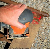 sanding a chair
