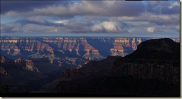 02 Dark sky over morning sunlit temples from Lodge NR GRCA NP AZ pano (1024x556)