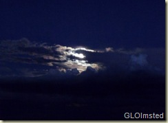 Full moon behind clouds from Marble View Kaibab National Forest Arizona