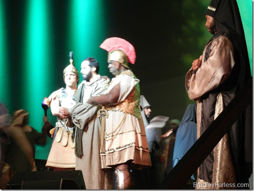 Jesus being detained by two Roman centurions, while a Jewish priest looks on. (Times Square Church Easter Production, 2011)