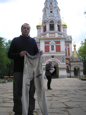 Galin, holding my newly mended trousers just before I threw them away for a new pair.