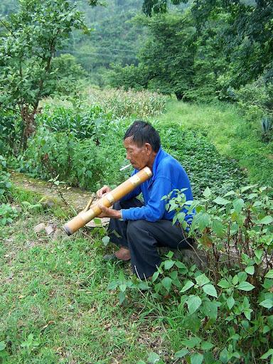 Yi Nationality Farmer, with giant smoking aparatus