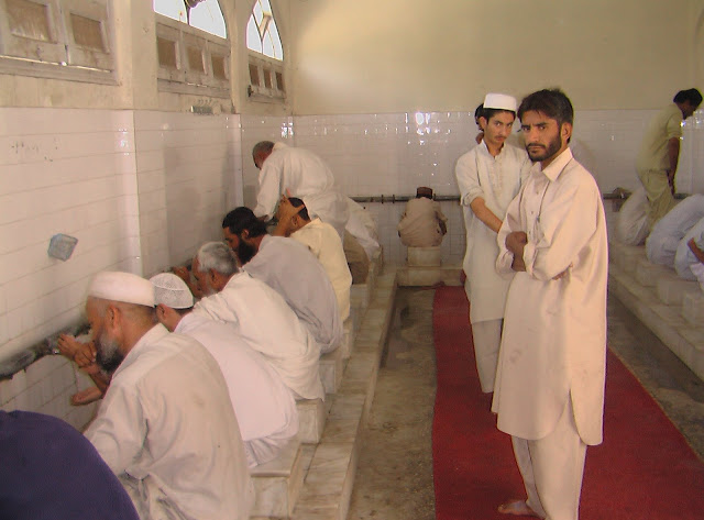 Mosque, washing hands,arms, face, feet before prayers  Hygiene sanitation for muslims  five times a day