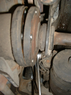 Then its time to crawl back under the car and take loose the six bolts that hold the axle to the output shaft.