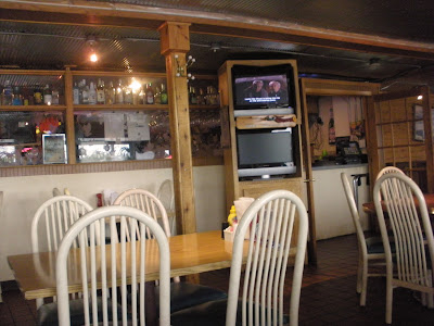 Theyre showing Grumpy Old Men on the TV!  What are the odds?  Oh see the small ice fishing pole below the TV thats the Green Hornet!