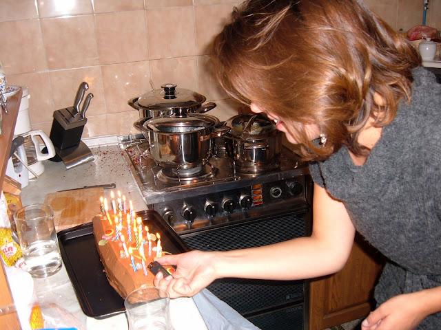 Ivana Lighting the Birthday Log