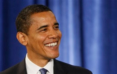 President-elect Barack Obama smiles during a news conference in Chicago, Tuesday, Nov. 25, 2008. (AP Photo/Charles Dharapak)