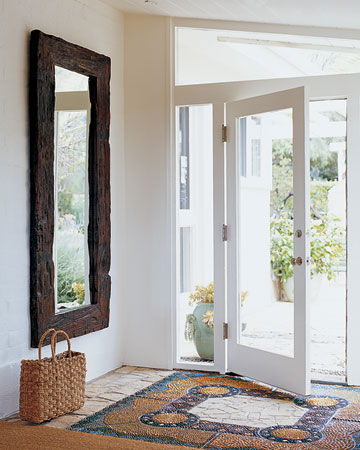 Beautiful tile work at the door elevates the space. (marthastewart.com)