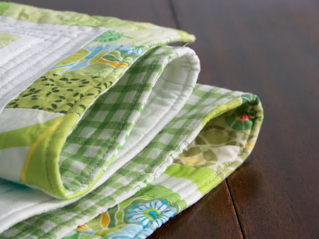 spring green and white quilted tablerunner