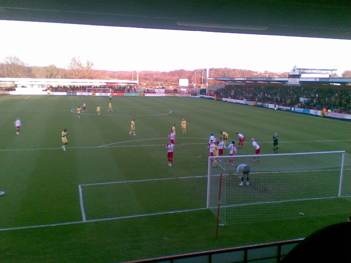 A Rushden headers goes just over.