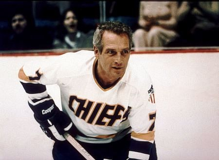 Those baby blues...sigh... straight from the lips of Lady Bee! Slap Shot is a classic, and we could not leave the late, great Paul Newman off our list!
