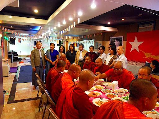 Burmese community brings food offerings to Monks