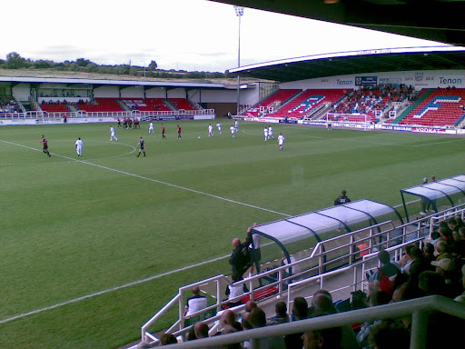 Histon take the lead in front of their travelling fans (right of pic).