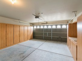 El Mirage Home for Sale showcases this garage with cabinets