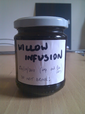 Jar of willow bark infusion, labelled with the date, expiry date, and DO NOT DRINK