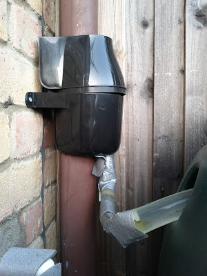 Drainpipe diverter and gaffer-taped tube to water butt