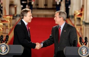 Tony Blair and George W. Bush shake hands after their press conference in the East Room of the White House on 12 November 2004.