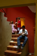 Kids eating cake on the stairs in our house.