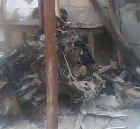 Photo of the suicide bombers' destroyed car. Credit Compass Direct News.