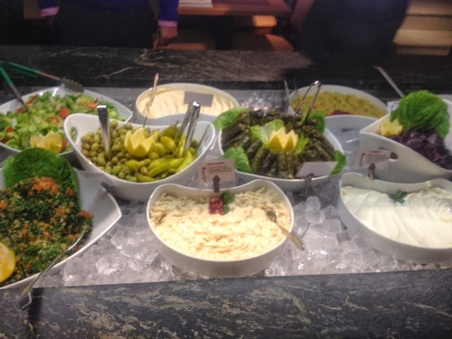 salad of tabouleh, olives and humus at the Rodizio Lebanon buffet