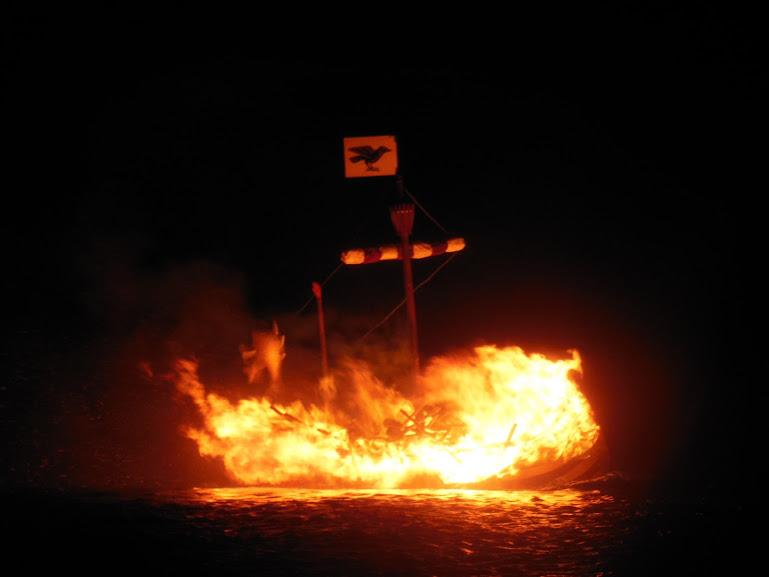 Viking ship burning Up Helly Aa festival in Cullivoe, Shetland