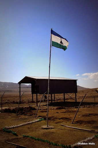 the flag of lesotho at the lesotho border post