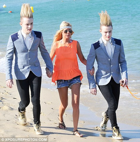 Jim Carrey: Who says three's a crowd! Jedward accompany Tara Reid on 'romantic' beach walk... dressed in matching suitsThey flew out to keep their ...