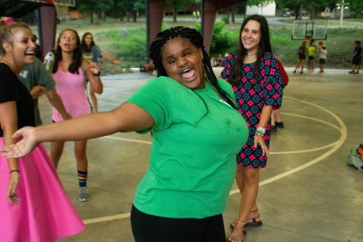 A Camp Barnabas Participant Is Dancing And Having Fun With Friends.