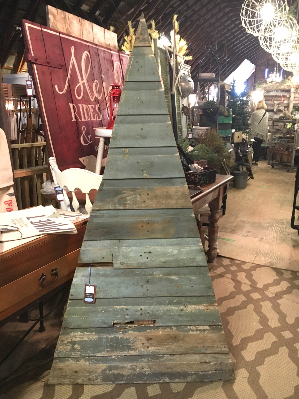 rustic christmas tree display of salvaged wood boards painted green