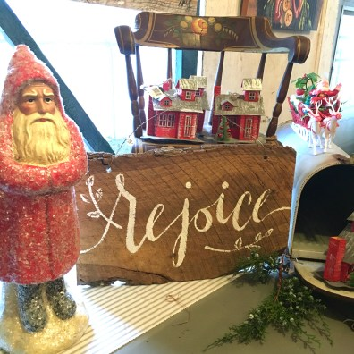 """rustic holiday sign that reads """"rejoice"""""""