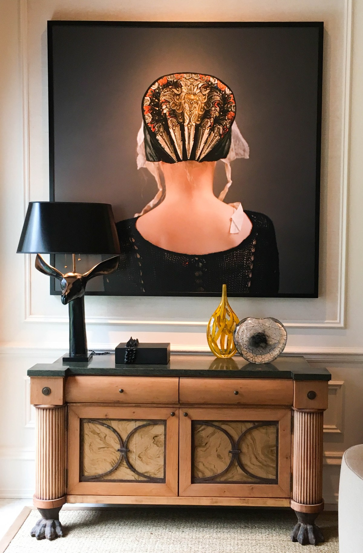Stunning art piece by Trine Sondergaard features the head and shoulders of a woman from behind, making her intricately designed bonnet the main focus of this contemporary portrait.