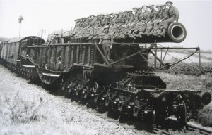 Photo taken during World War 2 of a large gun being transported by rail through the marshes