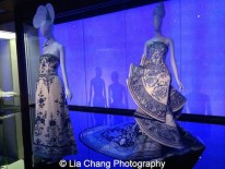 Gallery view, Chinese Galleries, Frances Young Tang Gallery, Blue and White Porcelain. (L-R) House of CHANEL (French, founded 1913),Karl Lagerfeld (French, born Hamburg, 1938), House of Lesage (French, founded 1922), Evening dress, spring/summer 1984 haute couture, White silk organza, tulle, and taffeta embroidered with blue, white, and crystal beads Courtesy of Collection CHANEL, Paris; Guo Pei (Chinese, born 1967), Evening gown, spring/summer 2010 haute couture, Blue and white silk satin embroidered with crystals and blue and white silk thread, Courtesy of Guo Pei. Photo by Lia Chang